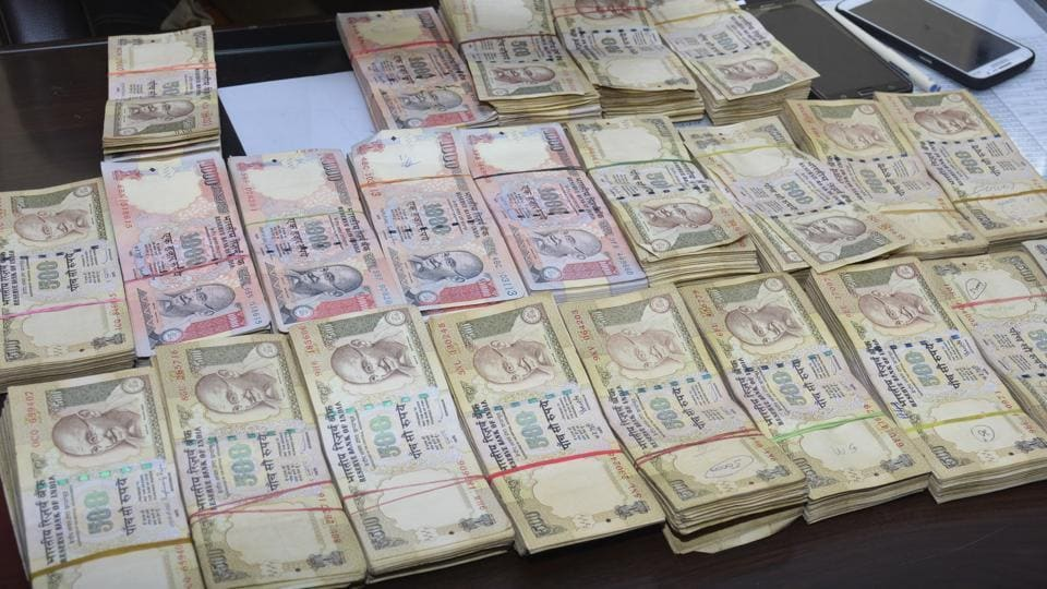 Gujarat Police seized the old notes during an operation on the Udhna main road.
