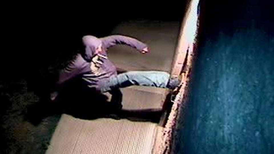 A suspect is shown in this still photo taken from surveillance video on March 26 in Fort Collins, Colorado, and provided on March 27.