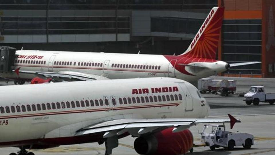 FILE - In this May 18, 2012 file photo, Air India planes are parked on the tarmac at the Terminal 3 of Indira Gandhi International Airport in New Delhi, India. An Air India plane flying to London was forced to return to Mumbai after passengers spotted a rat on board, the airline said Thursday, Dec. 31, 2015. (AP Photo/Kevin Frayer, File)