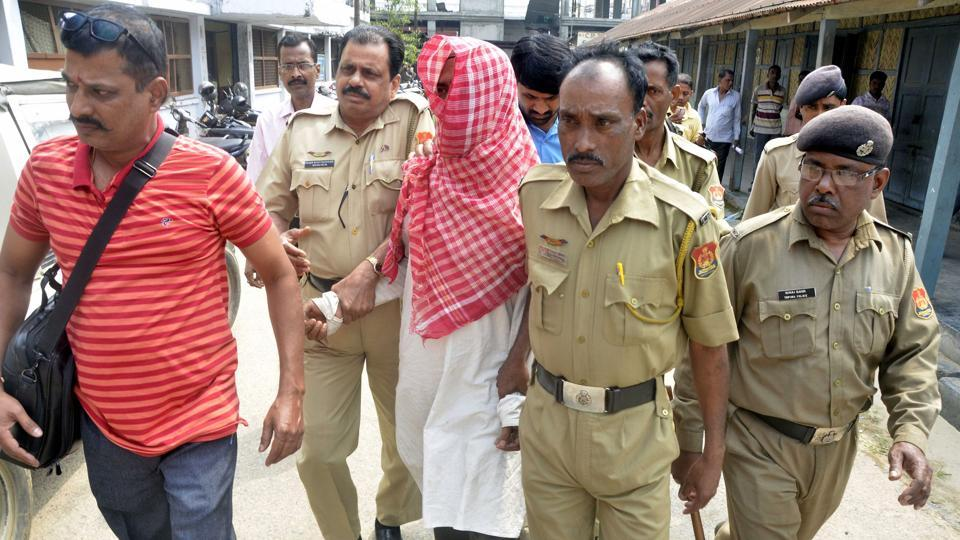 Suspected militant Habib Miya escorted by police to a court in Agartala on March 18, 2017. He is accused of involvement in a 2005 attack on the Indian Institute of Science (IIS) in Bangalore that killed one and wounded four others.