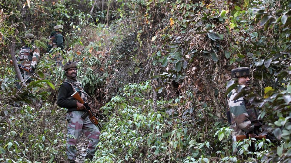 Indian Army personnel take position during an operation in Akhnoor district near the international border with Pakistan.