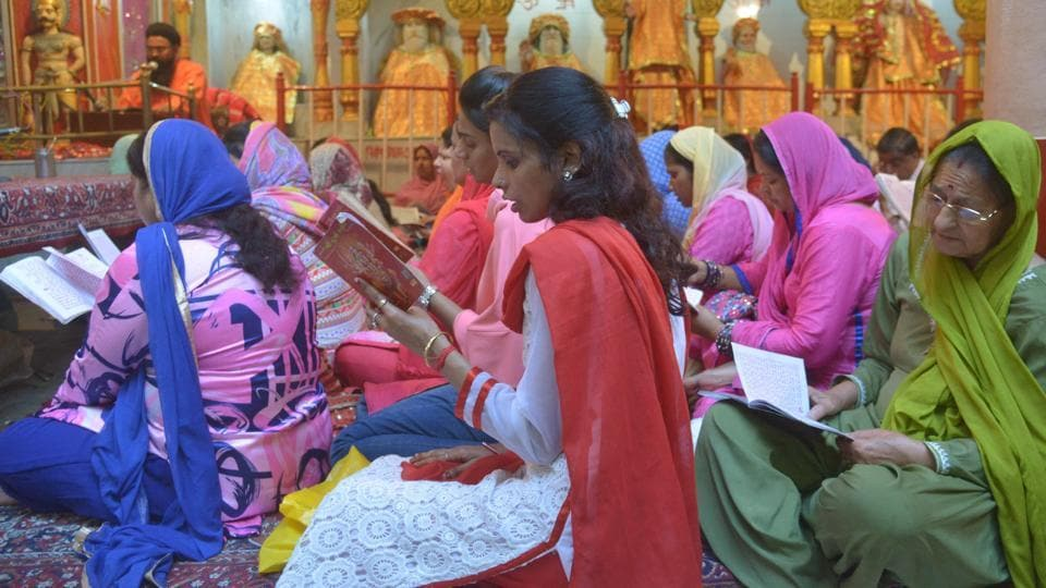 Indian Hindu devotees offer prayers for the Navratri Festival at the Mata Longa Wali Devi temple in Amritsar. As people observe fasting and meditation during these nine days, they also maintain a generally positive, calm and peaceful demeanour, aided by the strictly vegetarian diet followed these nine days. (Narinder Nanu / AFP)