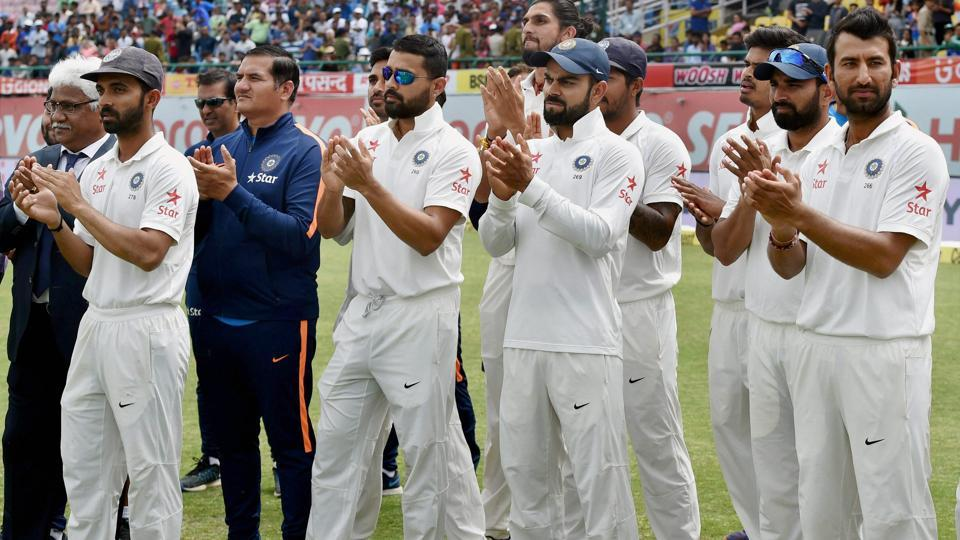 India skipper Virat Kohli with teammates at the award ceremony after winning the Test series against Australia at HPCA Stadium in Dharamsala on Tuesday.