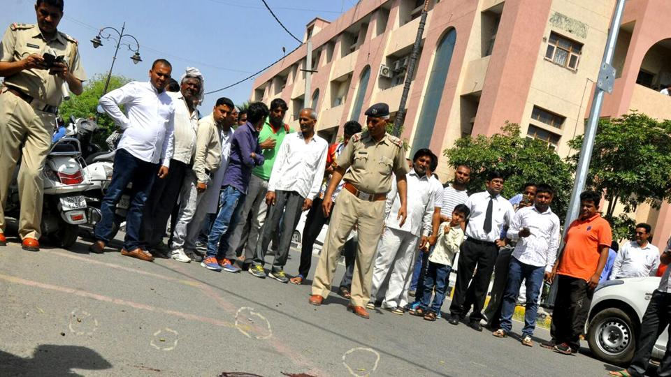 Police investigating outside Rohtak court where shootout killed one and injured seven.