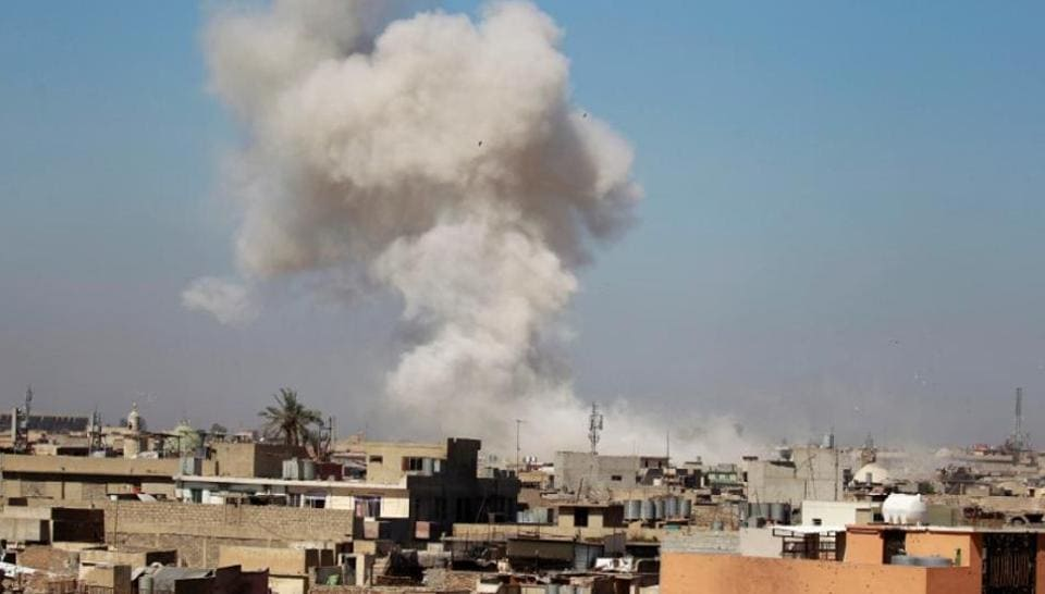 Smoke rises over the city during clashes between Iraqi forces and Islamic State militants, in Mosul, Iraq.