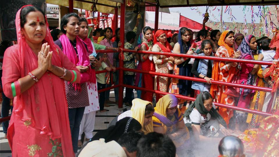 Devotees offer prayers inside the historical Kali Mata Temple on the first day of the Navratri festival in Jammu. (PTI)
