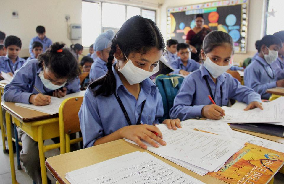 Gurgaon: Students wearing anti-air pollution mask as protective gear as pollution reached hazardous levels in the classroom