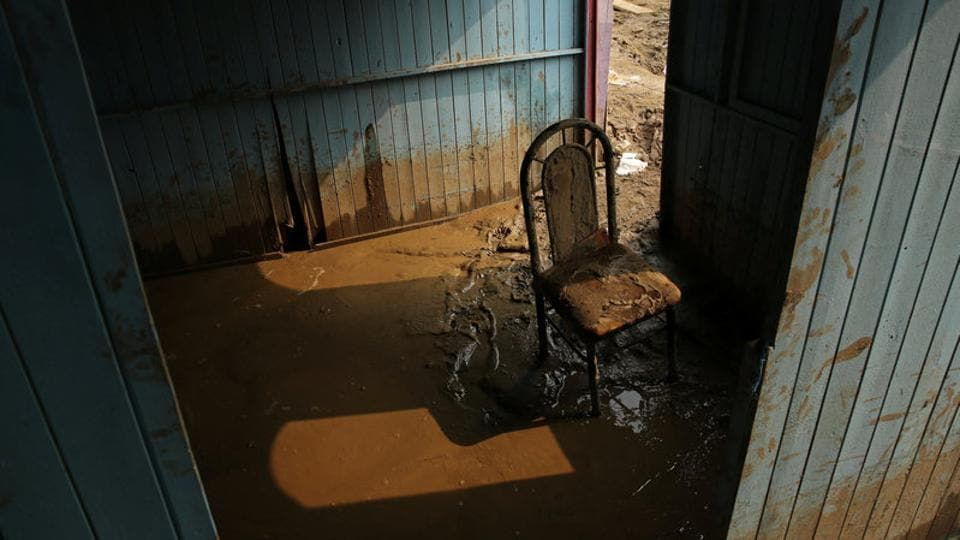 A chair stands in mud at the home of Francisco Coca. (Mariana Bazo/REUTERS)