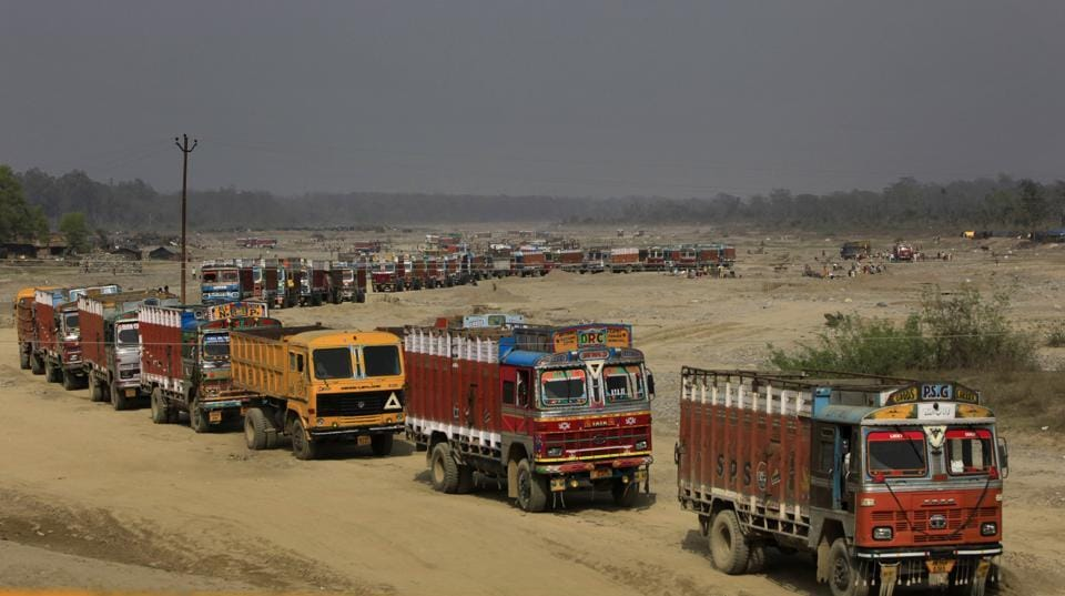 The trucks lined up to collect sand and stone from a tributary of river Ganga in Uttarakhand. Most of the minerals from the river bed being lifted are said to be illegal and locals claims the activity has increased in the last few months since the state went to elections.