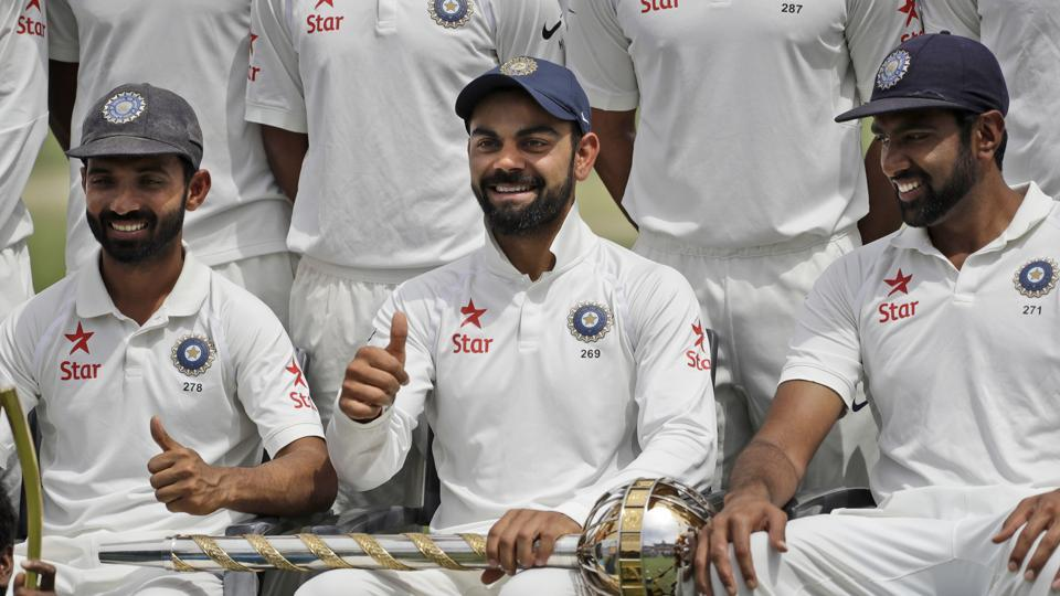 India's captain Virat Kohli gestures as the team poses with the Border-Gavaskar Trophy and the Test mace after winning the fou-match Test series against Australia in Dharmsala on Tuesday.