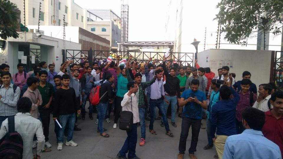The employees of Chinese mobile company and IPLsponsors Oppo waved Indian flags to mark their protest outside Sector 63 assembling unit in Noida on Tuesday.
