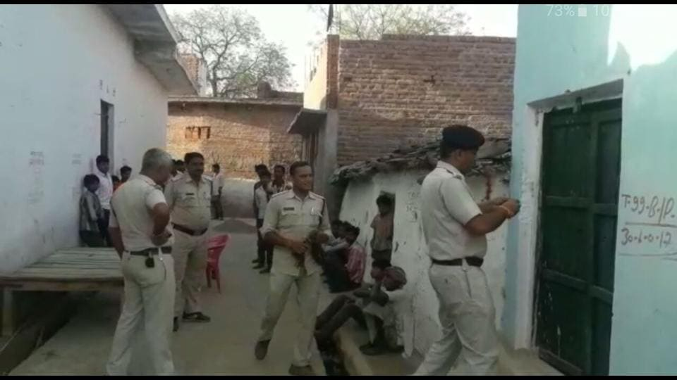 Police at the house of Niranjan Ahriwar in Dharampura village, where the incident took place.
