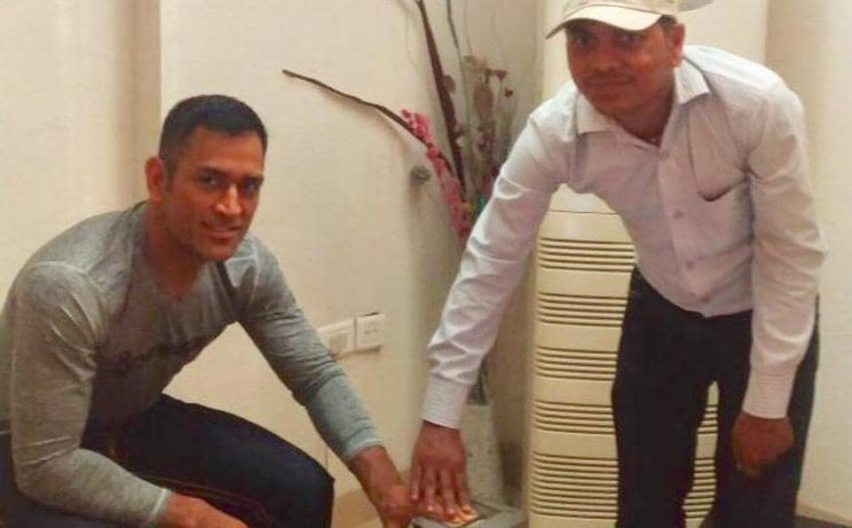 Former cricket captain Mahendra singh Dhoni gets his fingerprints scanned while applying for an Aadhaar card. The picture was tweeted by Common Services Centre on Tuesday.