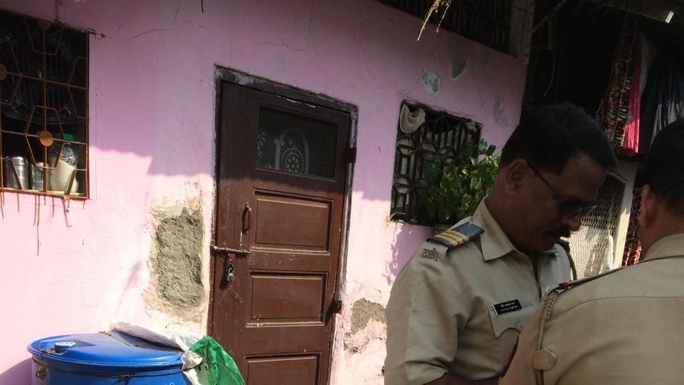 Policemen inspect couple's residence in Nagpada on Tuesday.