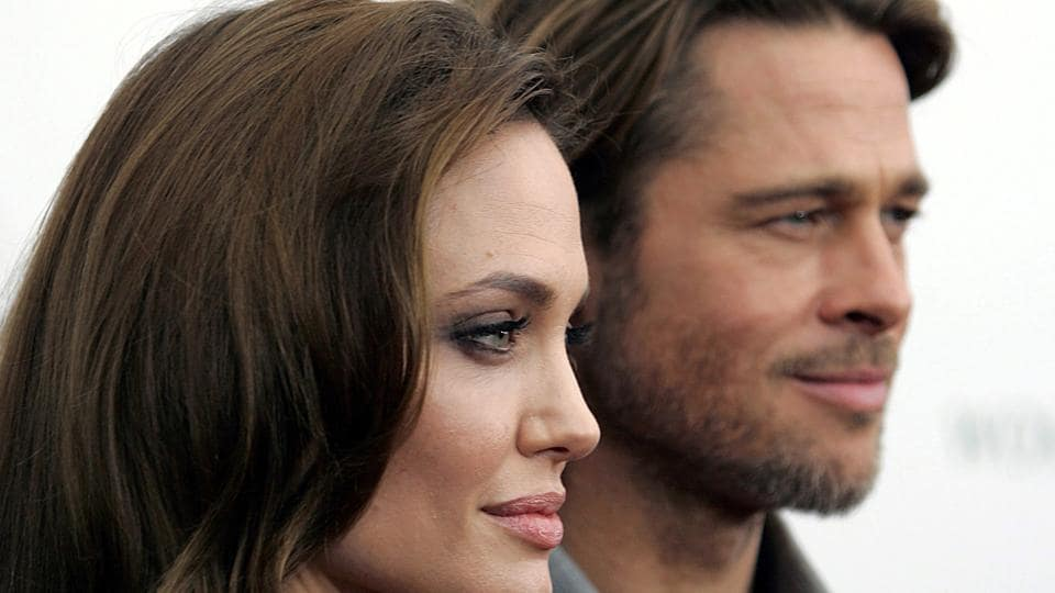 Angelina Jolie and Brad Pitt arrive at the screening of her directorial debut In the Land of Blood and Honey in New York December.