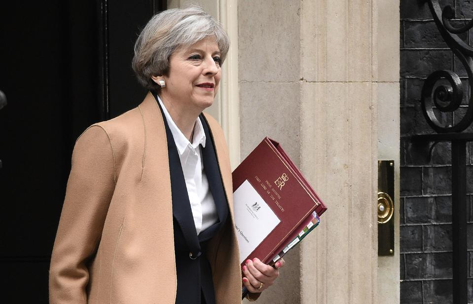 British Prime Minister Theresa May leaves 10 Downing Street for the Houses of Parliament on Wednesday.