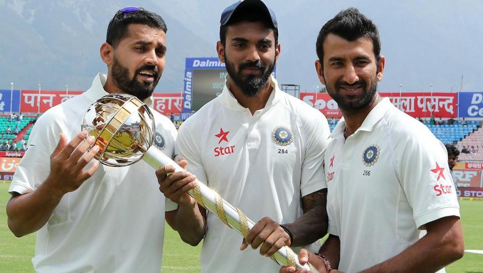 Murali Vijay, KL Rahul and Cheteshwar Pujara with the Test Championship mace in Dharamsala.