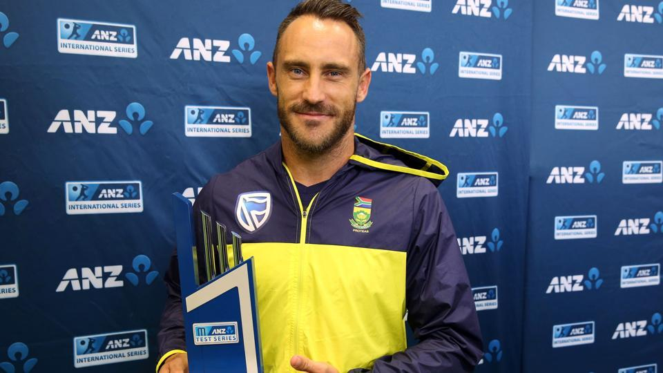 Faf du Plessis holds the trophy after the day five of the third Test cricket match between New Zealand and South Africa was called off due to rain.