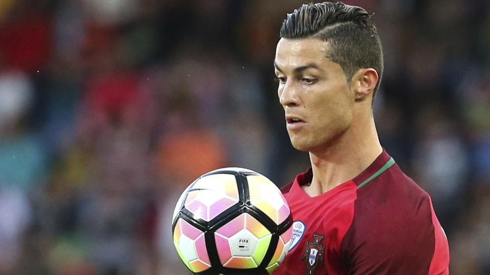 Cristiano Ronaldo controls the ball during the international friendly match between Portugal and Sweden.