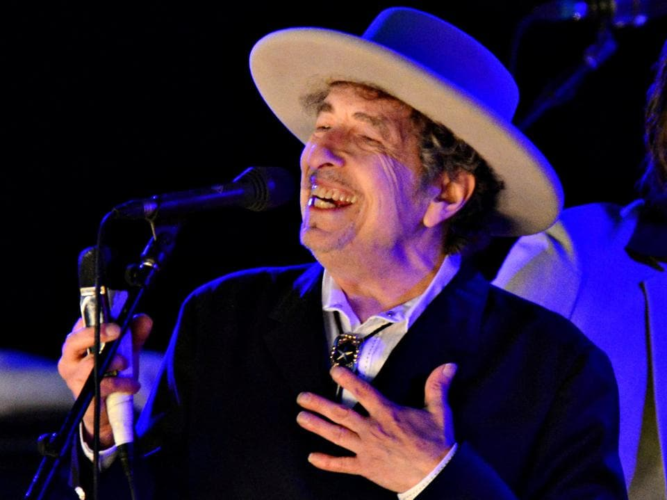 "Singer-songwriter Bob Dylan snubbed the Nobel ceremony in December because of ""pre-existing commitments""."