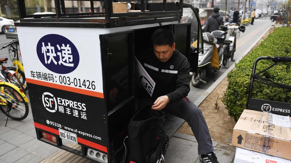 From making illegal cross-border deliveries to China in a minivan to buying a fleet of Boeing aircraft, the boss of SF Express has ridden a wave of online shopping to become one of the country's richest men.