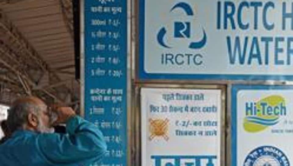 A man drinks water at an IRCTC Hi-Tech Water dispenser