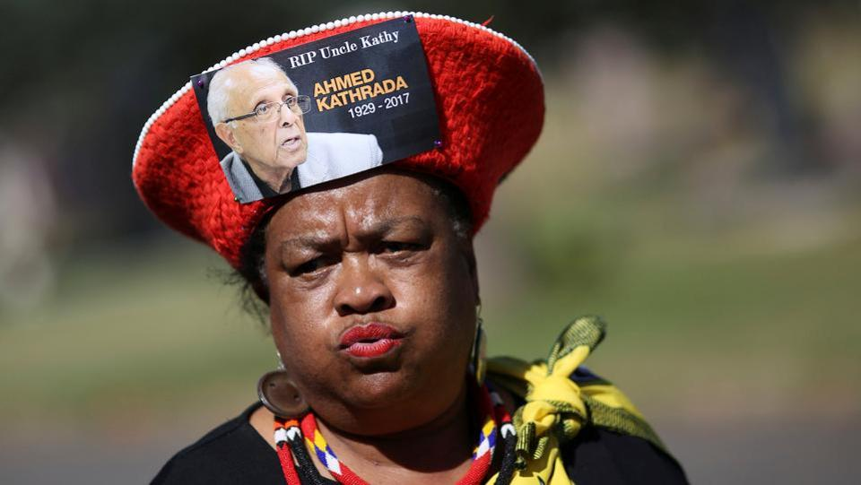 A mourner arrives wearing a hat bearing a picture of Ahmed Kathrada, who was sentenced to life imprisonment alongside Nelson Mandela, during his funeral at the Westpark Cemetery in Johannesburg, South Africa. (Siphiwe Sibeko/REUTERS)