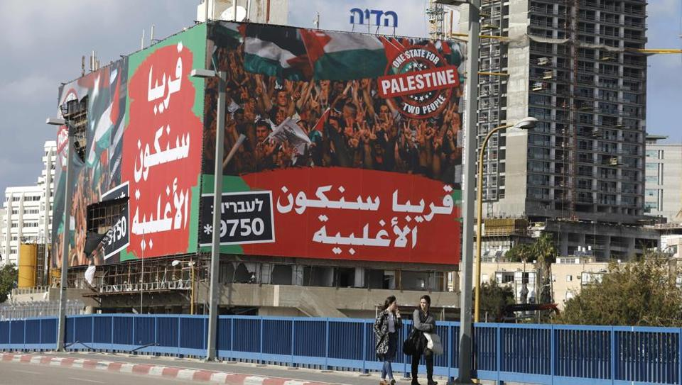 "A large advertising banner in the Israeli city of Tel Aviv on January 15, 2017, in Arabic reads: ""Soon we will be the majority"" and ""Palestine: One state for two people"" in English. The ad, which appeared in Israeli dailies, makes references to the West Bank's growing Arab population, which supporters of a two-state solution warn ""will destroy Israel's identity as a Jewish and democratic state if a separate Palestinian state is not established alongside Israel""."