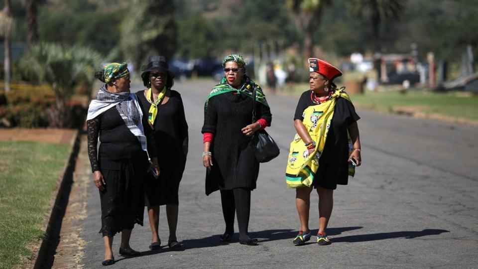 Mourners arrive for the funeral.  Kathrada denied all charges against him and was convicted on only one count, sabotage. He was released from prison in 1989, just months before Mandela himself walked free.  (Siphiwe Sibeko/REUTERS)
