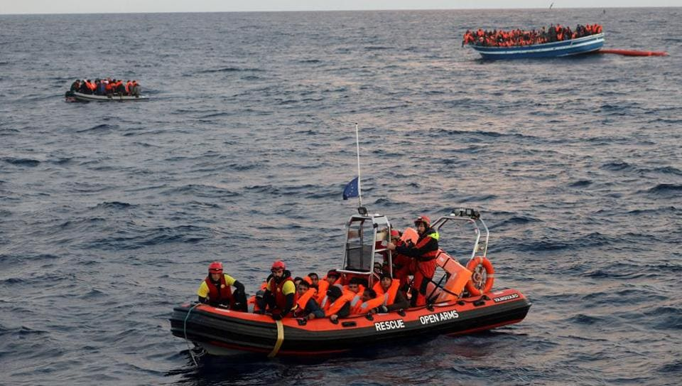 Over 400 migrants are seen overcrowding a wooden vessel drifting in central Mediterranean Sea off the Libyan coast on March 29.