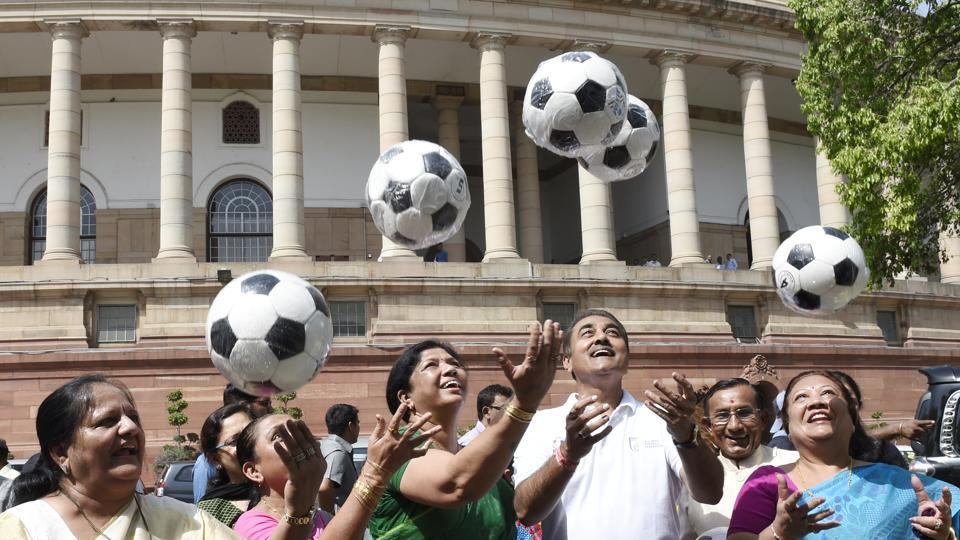 In a bid to raise awareness of the U-17 Fifa World Cup, which will take place in India in October, sports minister Vijay Goel gifted every MP a football on Wednesday morning at the parliament. (Arvind Yadav/HT PHOTO)