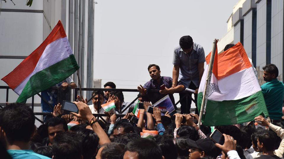 Indian employees of mobile phone company Oppo protest outside their office in Noida's Sector 63 after a Chinese national allegedly threw India's national flag in a dustbin.