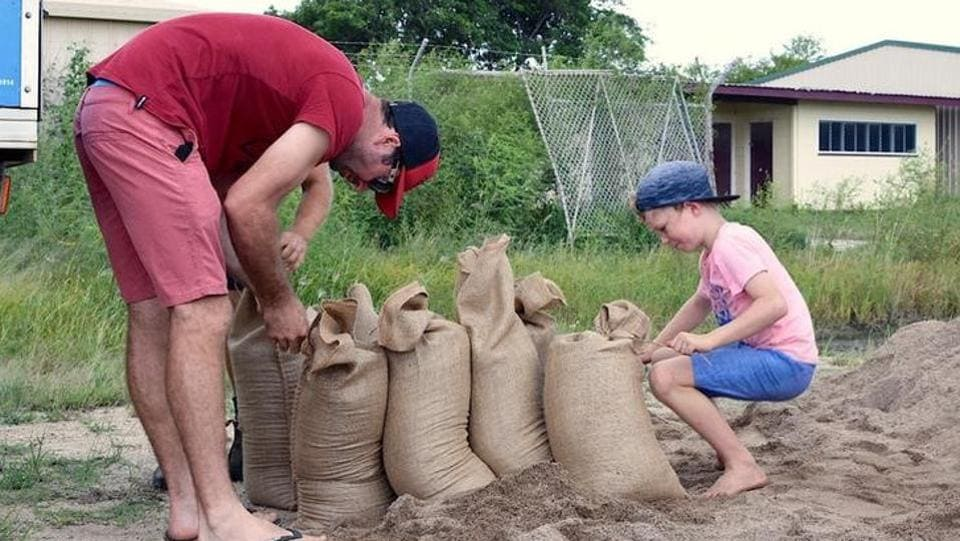 Residents fill sandbags in preparation for the arrival of Cyclone Debbie in the northern Australian town of Bowen, located south of Townsville. (AAP/Sarah Motherwell/via REUTERS)