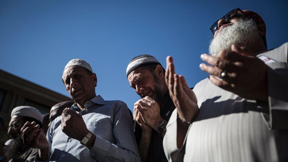 Mourners pray during the wake for South African anti-apartheid activist Ahmed Kathrada at Masjid Al Furqan in Houghton. He was acquitted in the 1956-61 mass treason trial but was placed under house arrest in 1962. He went underground a few months before being swept up in the arrests of anti-apartheid activists at Liliesleaf Farm on the outskirts of Johannesburg in 1963. Kathrada and Mandela were part of a group sentenced to life imprisonment after the historic Rivonia trial in 1964. (GUlshan Khan/AFP)