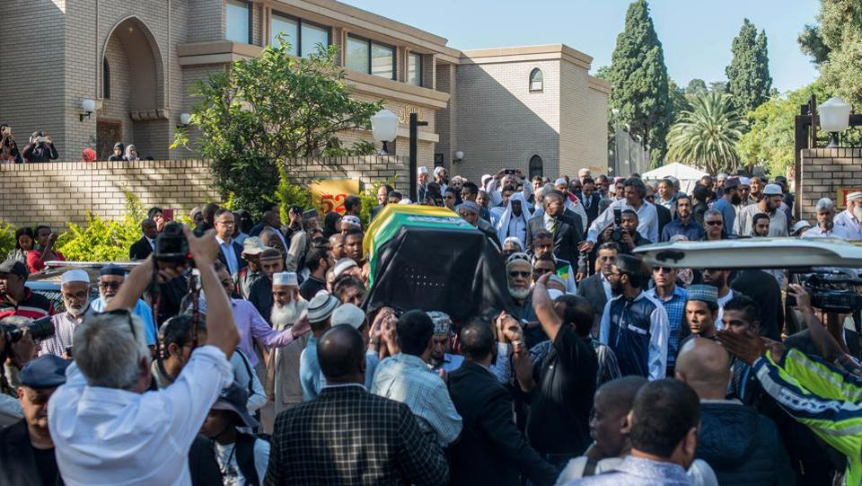 Mourners carry the coffin during the wake. During the past year, Kathrada was a regular at demonstrations and marches around South Africa, frequently offering his support to students protesting for free education. (Mujahid Safodien/AFP)