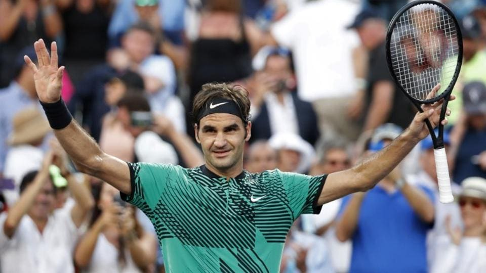 Roger Federer celebrates after his match against Roberto Bautista Agut at the Miami Open.
