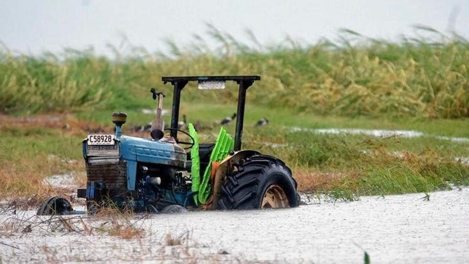 A tractor sits in a flooded sugar cane field after Cyclone Debbie passed through the area near the northern Australian town of Bowen, located south of Townsville in Australia. Great Barrier Reef islands popular with foreign tourists were also battered. (AAP/Sarah Motherwell/via REUTERS)