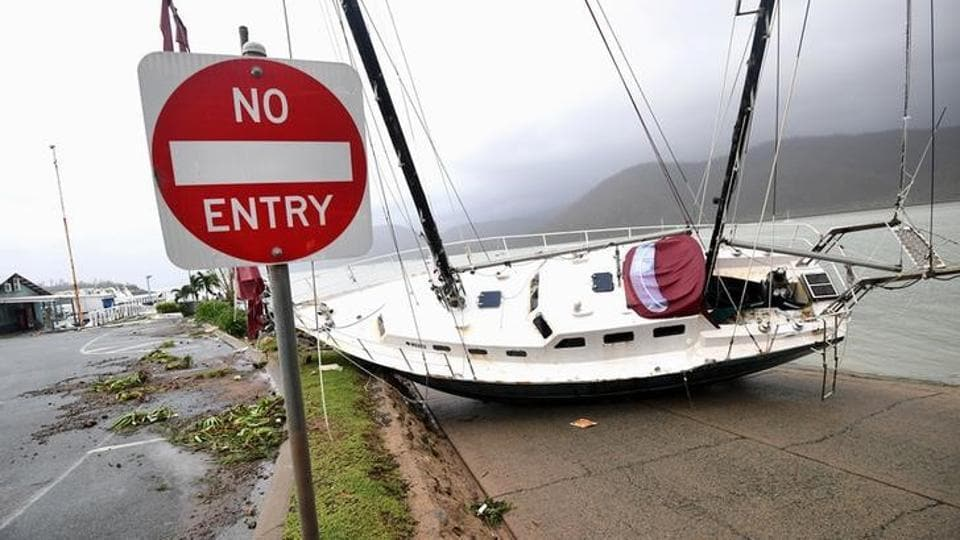 A boat is seen smashed against the bank at Shute Harbour, Airlie Beach. The storm was declared catastrophic by the Insurance Council of Australia. (AAP/Dan Peled/via REUTERS)