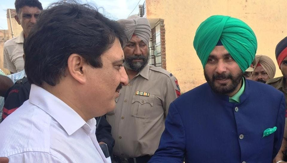 Navjot Singh Sidhu during his visit to Nayan Gaon area near Chandigarh on Thursday.