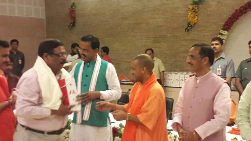 Chief minister Yogi Adityanath along with deputy CMs Dinesh Sharma and KP Maurya at his official residence on Wednesday.