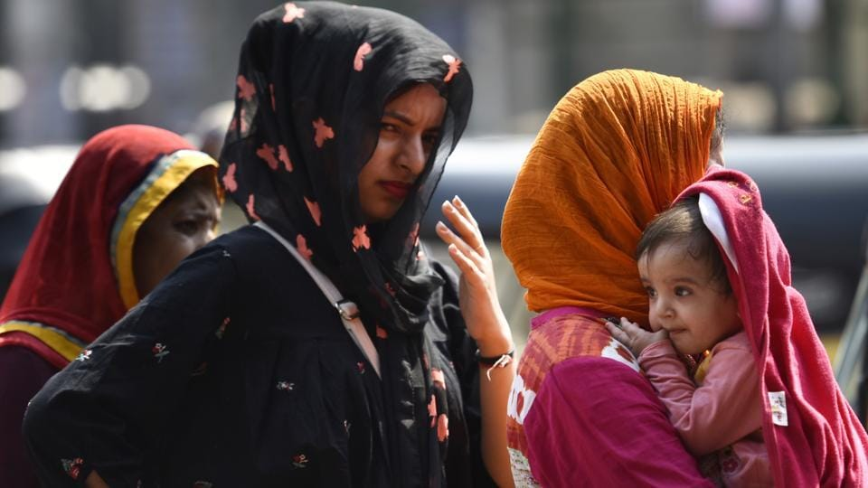 Women cover their heads to beat the heat at Bandra