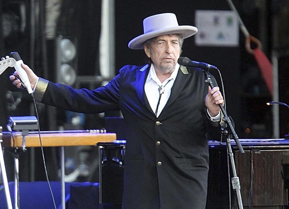 Bob Dylan collects his Nobel Prize
