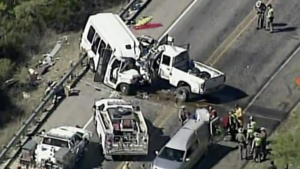 Authorities respond to a deadly crash involving a van carrying church members and a pickup truck on US 83 outside Garner State Park in northern Uvalde County, Texas, on Wednesday.