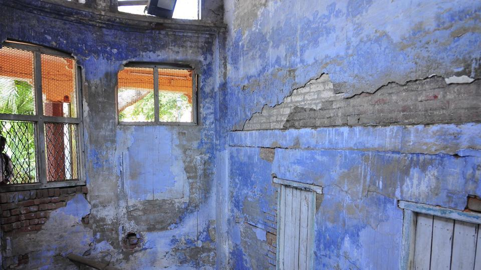 The dilapidated condition of inside wall of martyrs well at Jallianwala Bagh, Amritsar.