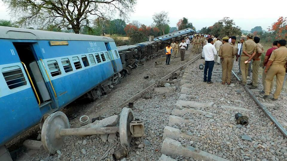 Rescue workers and officials inspect derailed coaches of the Mahakaushal Express train at Mahoba, some 140kms south-west of Kanpur, on March 30, 2017. More than 50 people were reportedly injured in the accident.