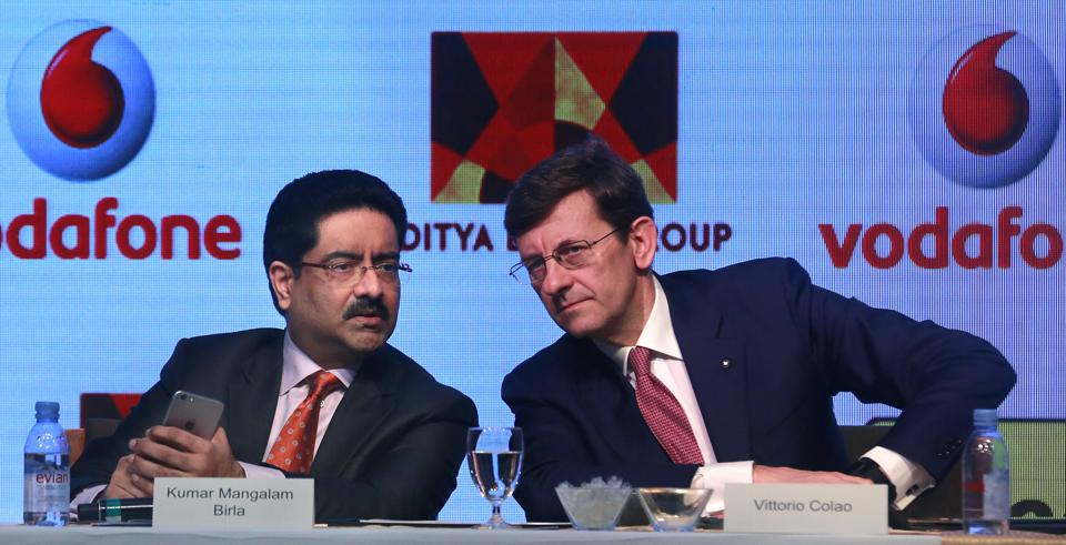 Aditya Birla Group chairman, Kumar Mangalam Birla, left, talks with Vodafone Group CEO Vittorio Colao, during a press conference in Mumbai, India, Monday, March 20, 2017.