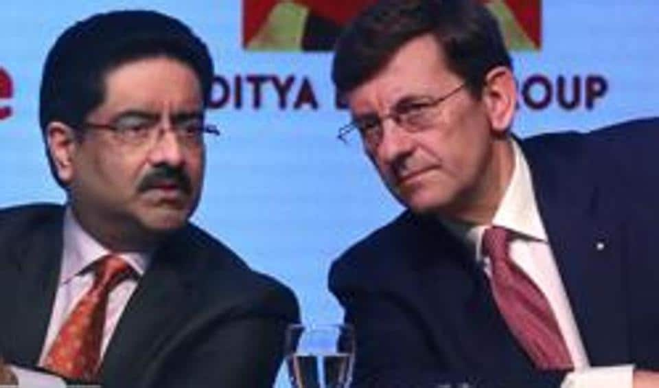 Aditya Birla Group chairman, Kumar Mangalam Birla, left, talks with Vodafone Group CEO Vittorio Colao, during a press conference in Mumbai. British telecom company Vodafone's Indian unit has announced a merger with Idea Cellular, creating the country's largest telecom operator with nearly 400 million customers.