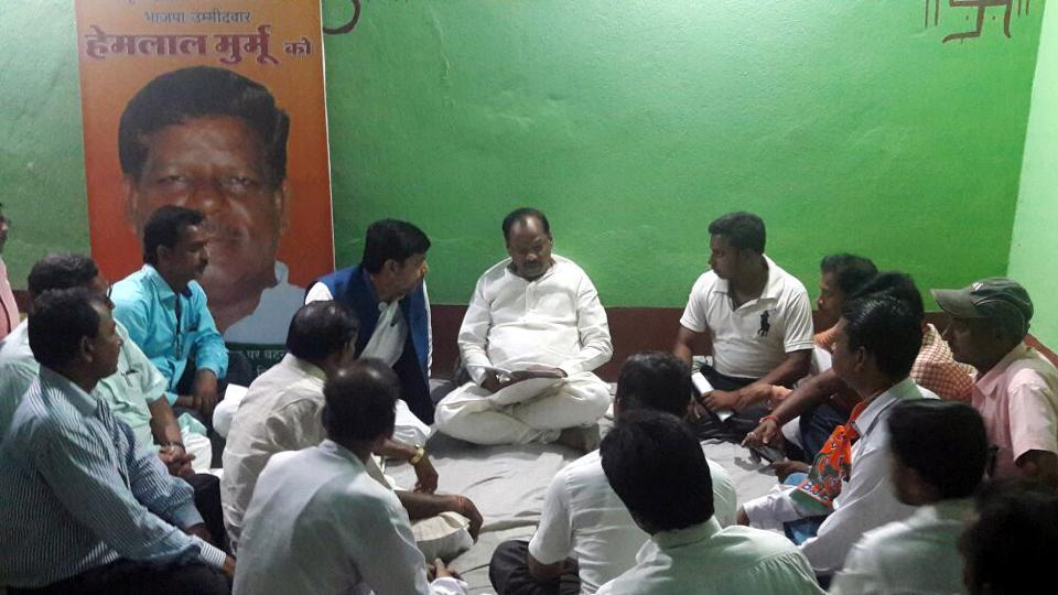 Chief Minister Raghubar Das conducting a meeting at BJP's election office for the Littipara bye- poll