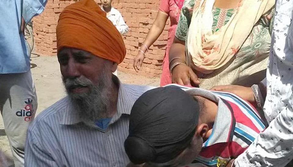 Grieving family members of the deceased, Sukhwinder Kaur, who was murdered at Ladowal area in Ludhiana on Wednesday.