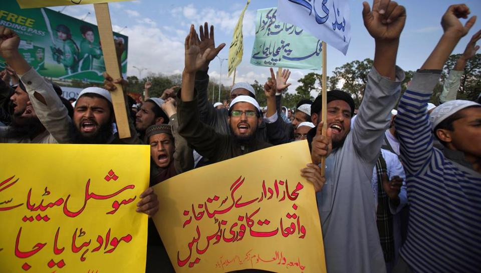 Pakistani students of Islamic seminaries chant slogans during a rally in support of blasphemy laws in Islamabad.
